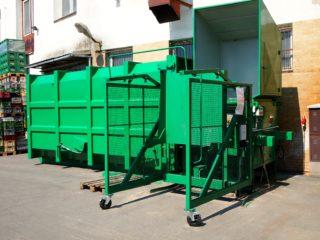 stacionární lisovací jednotka v zelené barvě